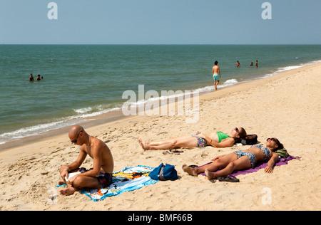 India, Kerala, Vypeen Island, Cherai Beach western sunbather - Stock Photo