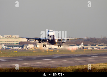 Monarch Airlines Airbus A320-212 taking off from London Gatwick - Stock Photo