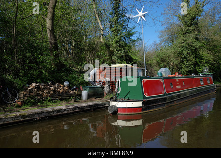A narrow boat with a wind turbine on the Shropshire Union Canal, England. - Stock Photo