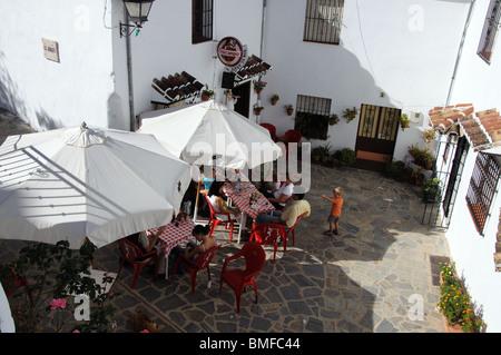 Courtyard restaurant, whitewashed village (pueblo blanco), Parauta, Serrania de Ronda, Malaga Province, Andalucia, - Stock Photo