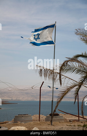 A torn Israeli flag blowing in the wind - Stock Photo