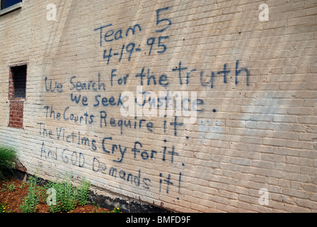 Graffiti on the wall of the Oklahoma City National Memorial Museum. - Stock Photo