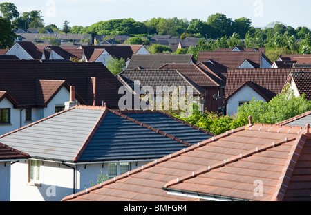 Roof tops of suburban houses in middle class area of Glasgow, Scotland, UK - Stock Photo