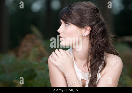 Shot of a Beautiful Teenage Girl in the Forest - Stock Photo