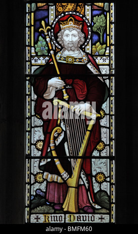 A stained glass window depicting King David with a harp, St Peter and St Paul Church, Wing, Rutland - Stock Photo