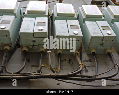 Row of electricity meters in hutongs, Beijing, China - Stock Photo