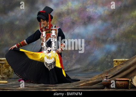 Yi minoity young woman in elaborate traditional costume, Nongzuo, Liangshan Yi Autonomous Prefecture, Sichuan, China - Stock Photo