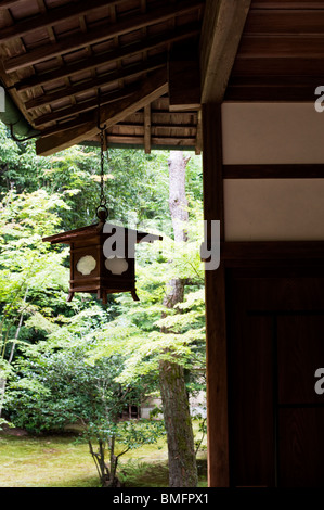 A wooden lantern hangs from the corner of a temple building at Koto-in, a sub-temple of Daitokuji Temple, Kyoto, - Stock Photo
