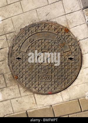 Sewer manhole in Beijing, China - Stock Photo