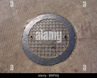 Sewer manhole in Guilin, China - Stock Photo