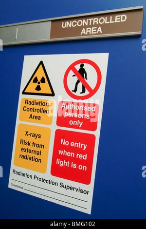 Radiation sign in a hospital unit UK - Stock Photo