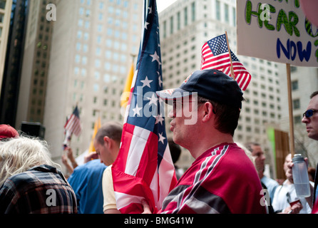 Members of the Illinois Tea Party movement rally at Chicago's Daley Plaza on Thursday, April 15, 2010. - Stock Photo