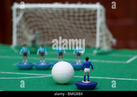 free kick with wall of players football soccer scene reinacted with subbuteo table top football players game - Stock Photo