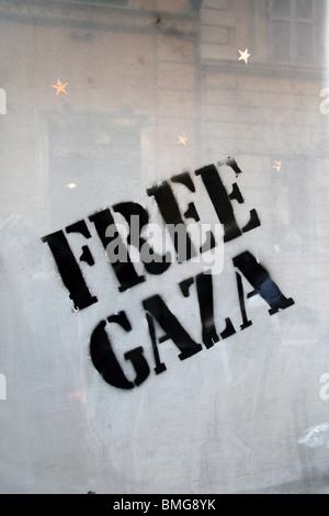free gaza graffiti on wall in rome, italy - Stock Photo