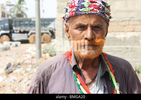 A Sufi Faqir (Beggar) roams the streets of Karachi in search of Alms - Stock Photo