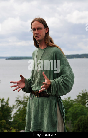 Man in viking costume in viking town Birka on Bjoerkoe Island, UNESCO World Heritage, Sweden - Stock Photo