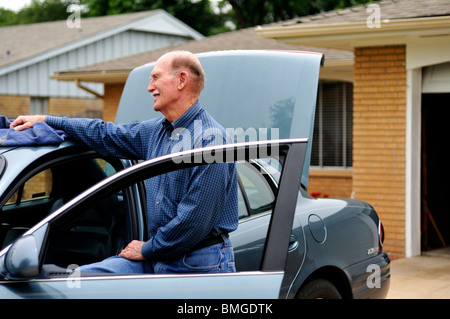A old man and his car. USA - Stock Photo