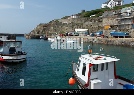 Boats in Portreath harbour, Cornwall UK. - Stock Photo