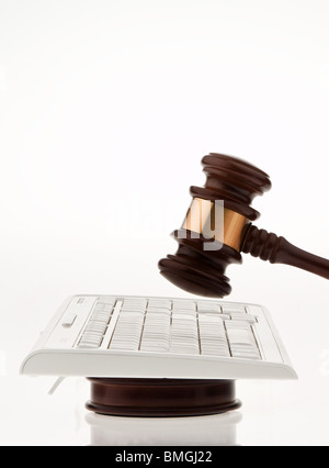 Judge hammer and keyboard. Legal certainty on the Internet. Internet auctions - Stock Photo