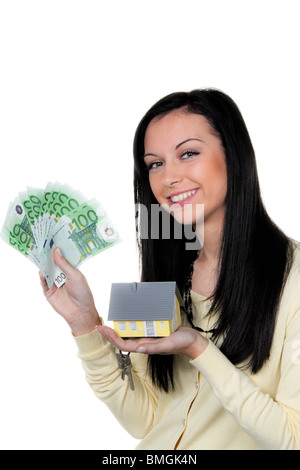 Woman with property and key after buying property - Stock Photo