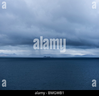 View from Isle of Skye across Little Minch towards Harris and Lewis, near Duntulm - Stock Photo