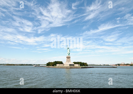 World famous Statue of Liberty in the distance on a late Autumn day - Stock Photo