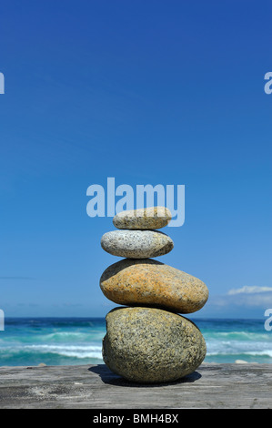 Four Zen stones and 4 elements stone, wood, sky, water found objects along 17 Mile Drive Pebble Beach Monterey California - Stock Photo