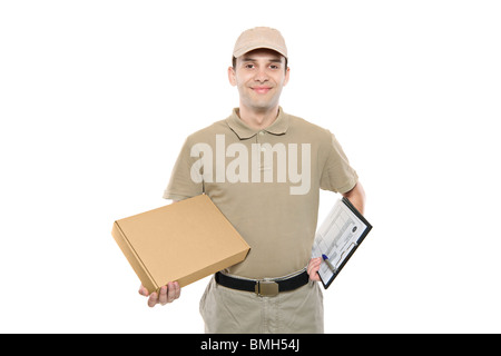 A delivery man bringing a package - Stock Photo