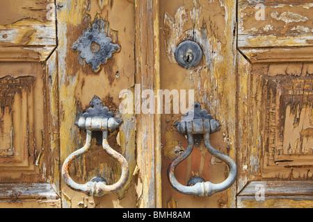 Rustic Door Lock on a Faded Brown Wooden Door - Stock Photo