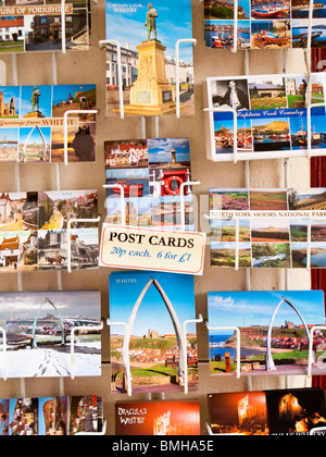 Postcards on a rack, Whitby, UK - Stock Photo