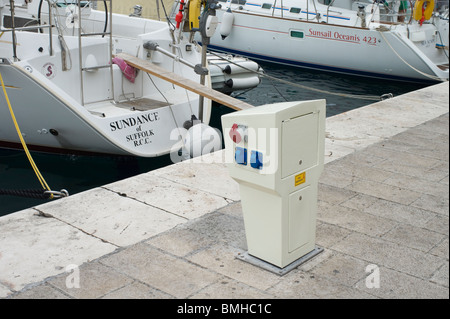 Croatia, Split, Dalmatian Riviera - Hvar Island - water and electricity supply for boats berthed in Hvar harbour - Stock Photo