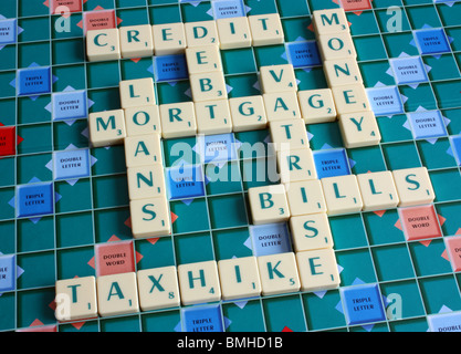 A scrabble board with numerous words implementing debt,credit & money worries - Stock Photo