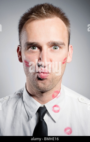 handsome young man with kisses on the chick and shirt - Stock Photo