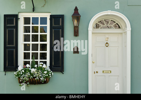 Detail of Door and Window of the Historic Charles Warham Home in Charleston, South Carolina - Stock Photo