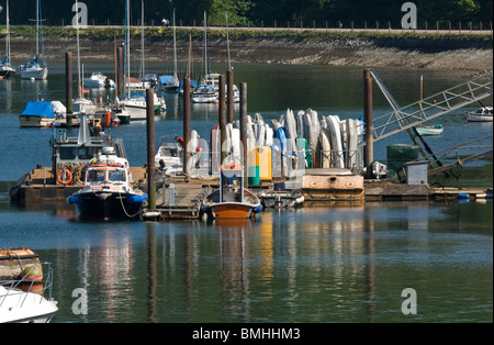 Mariner jetty with small boats and piles reflected in the water. - Stock Photo