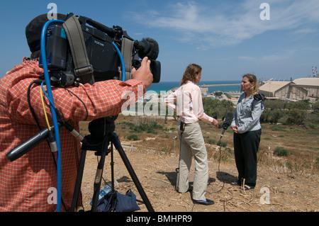 TV News crew interviews an Israeli army spokesperson near Gaza strip in Israel - Stock Photo