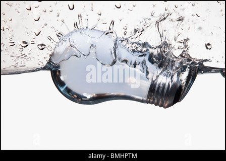 Light bulb floating in water - Stock Photo
