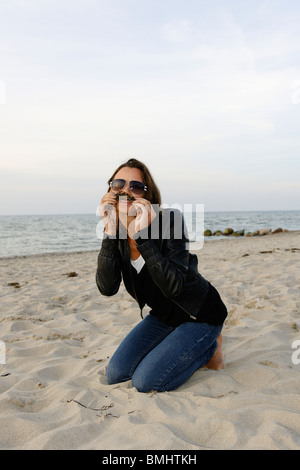Young woman, 20+, on a beach, casual, fun, athletic, Niendorf on the Baltic Sea, Schleswig-Holstein, Germany, Europe