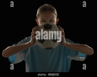 Soccer player and ball - Stock Photo