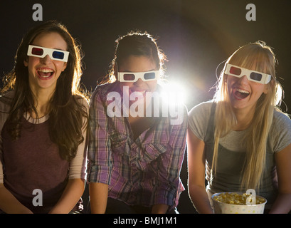 Young girls watching 3D movie - Stock Photo