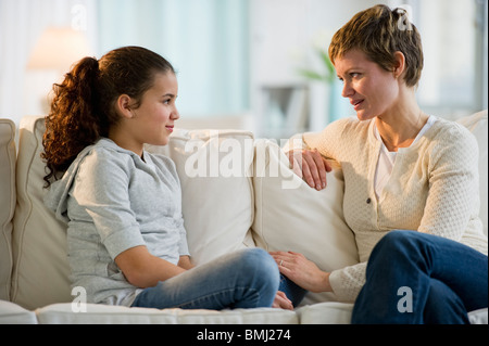Mother and daughter having a serious talk - Stock Photo