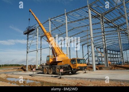 Huge mobile crane working on a building site in England - Stock Photo