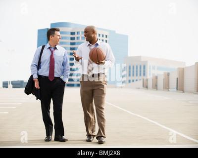 Businessman on their way to basketball game - Stock Photo