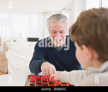 Father and son playing checkers - Stock Photo