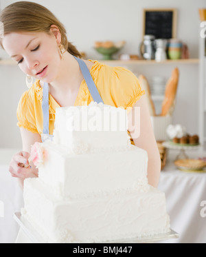 Woman working in bakery - Stock Photo