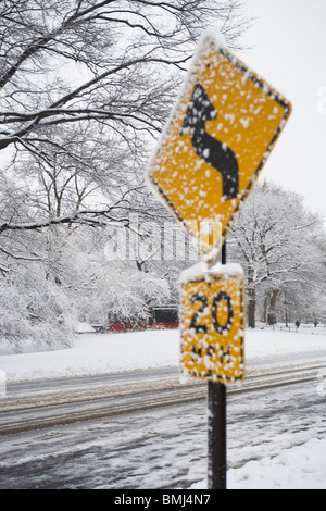 Speed limit sign covered in snow