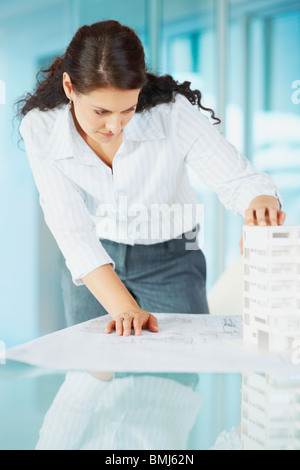 Woman looking at architectural model - Stock Photo