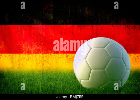 Grunge Germany flag on wall and soccer ball - Stock Photo