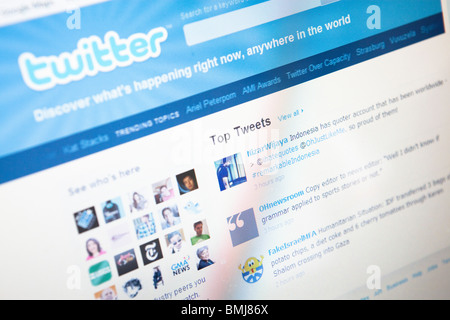 Close up of a computer monitor showing the social networking site Twitter - Stock Photo
