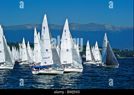 Start of the 2009 Bol d'Or yacht race on Lac Leman (Lake Geneva) with the Jura Mountains in the background. - Stock Photo